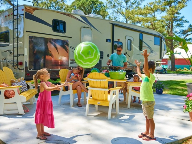 kids playing next to a rv