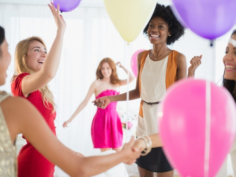 girls with balloons at a party