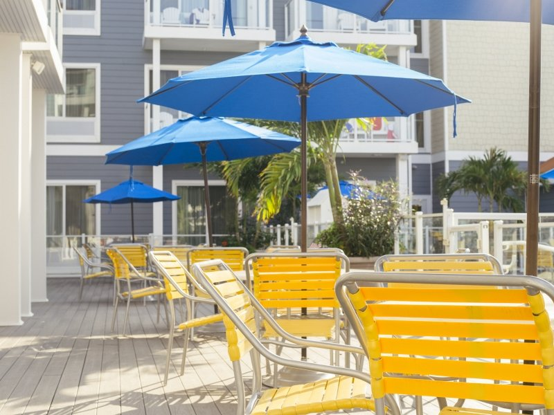 yellow Beach chairs and blue umbrellas