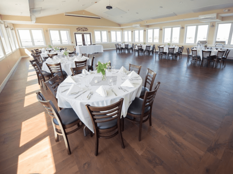 Banquet room with table and chairs set